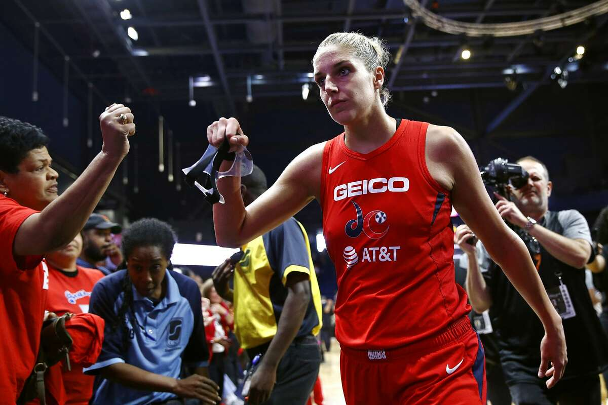Washington Mystics forward Elena Delle Donne walks off the court after Game 1 of basketball's WNBA Finals against the Connecticut Sun, Sunday, Sept. 29, 2019, in Washington. (AP Photo/Patrick Semansky)