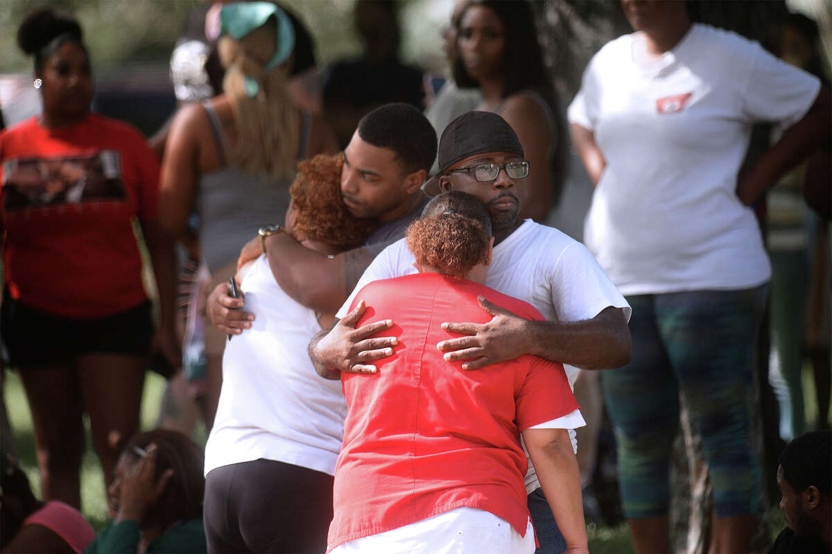 Beaumont Police investigate the shooting deaths of four people at a home at the intersection of Highland Avenue and Lavaca Street Sunday afternoon. Friends and family members of the victims gathered across the street for several hours after the shooting. Photo taken Sunday, 9/29/19