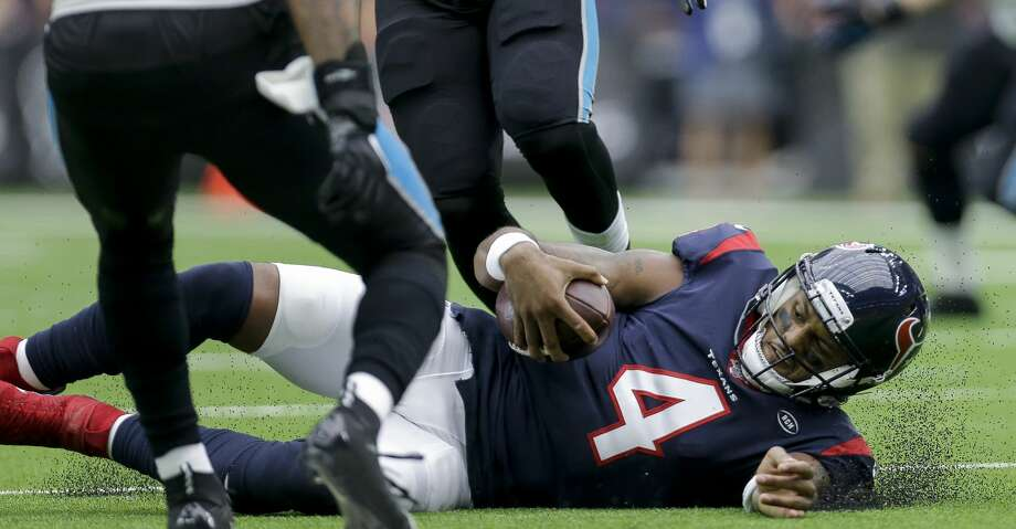 Houston Texans quarterback Deshaun Watson (4) slides after scrambling out of the pocket against the Carolina Panthers during the second quarter of an NFL game at NRG Stadium Sunday, Sept. 29, 2019, in Houston. Photo: Godofredo A Vásquez/Staff Photographer