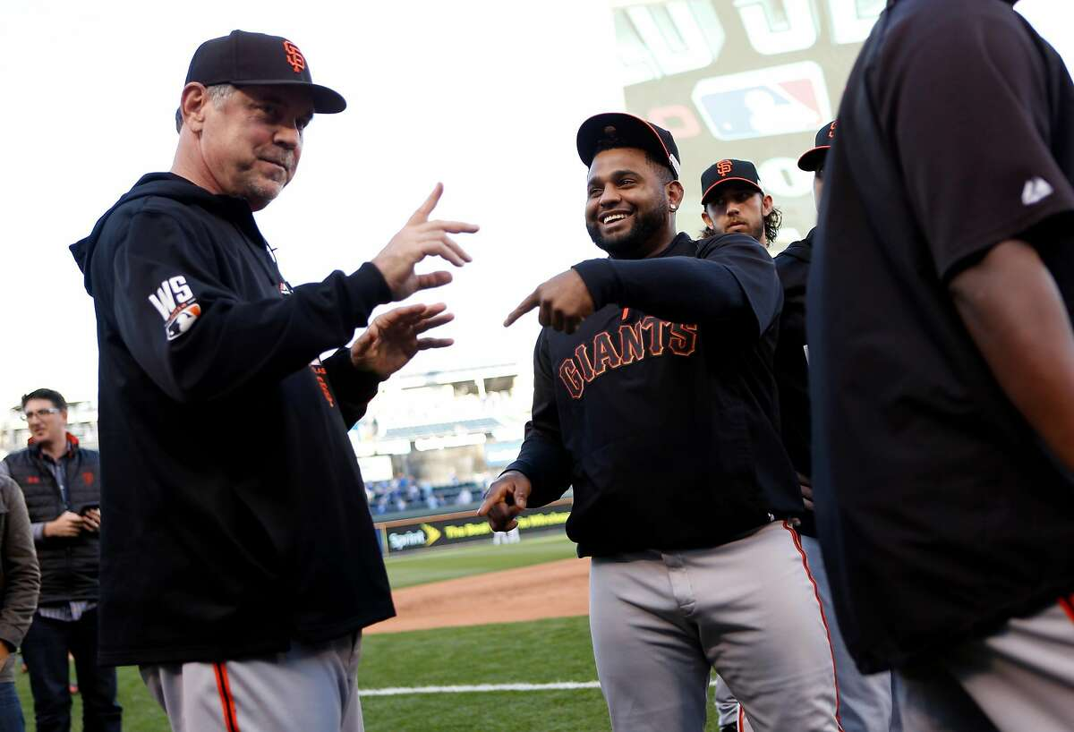 San Francisco Giants' manager Bruce Bochy and Pablo Sandoval joke before the Giants play the Kansas City Royals in Game 6 of the World Series at Kauffman Stadium in Kansas City, Missouri. on Tuesday, October 28, 2014.