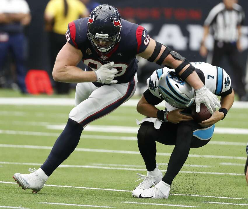 Houston Texans defensive end J.J. Watt (99) misses a sack of Carolina Panthers quarterback Kyle Allen (7), as Allen ducks under Watt and then threw for a first down, during an NFL football game at NRG Stadium on Sunday, Sept. 29, 2019, in Houston.