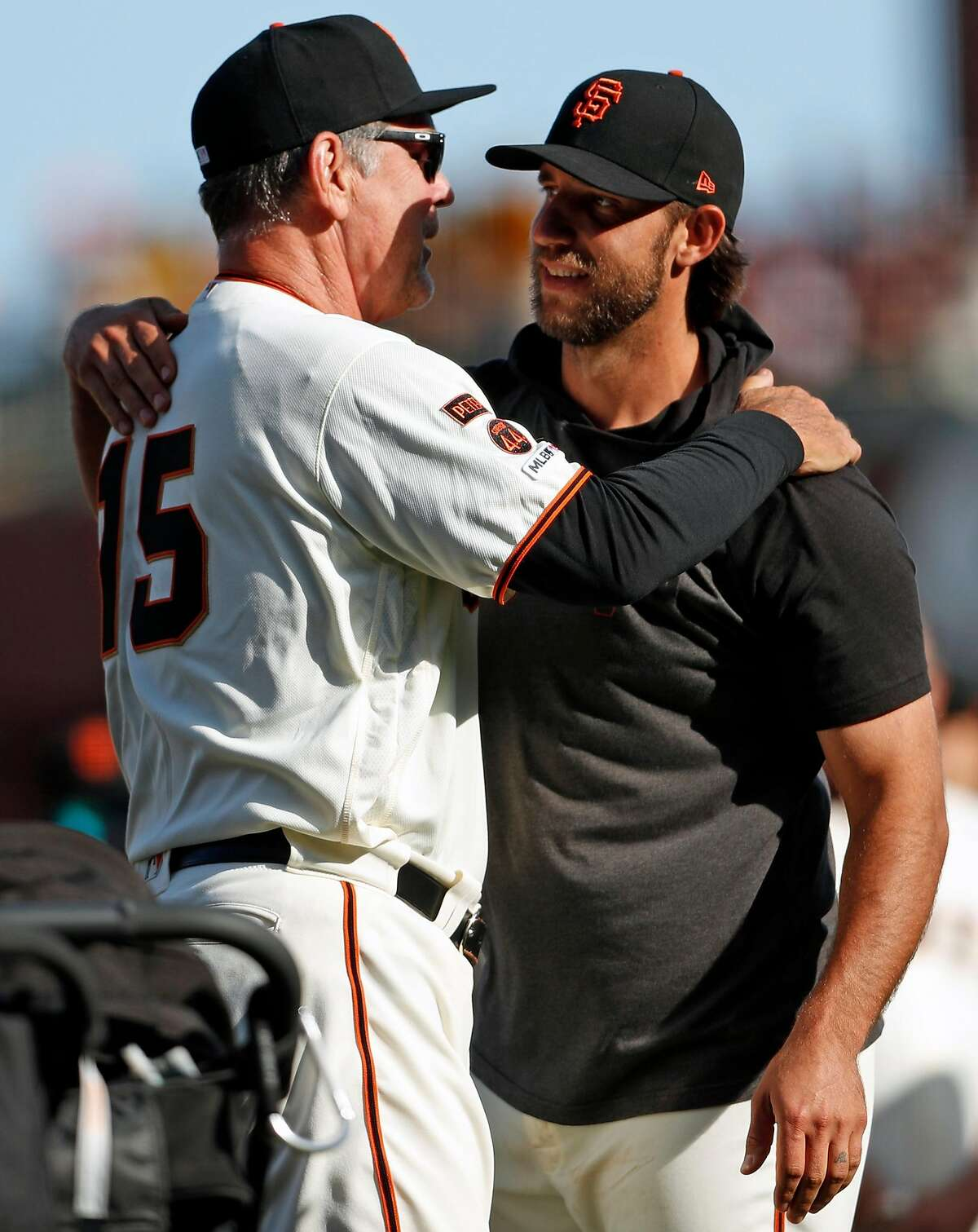 San Francisco Giants' Madison Bumgarner embraces Bruce Bochy as Bochy is honored after final game as manager of Giants at Oracle Park in San Francisco, Calif., on Sunday, September 29, 2019.