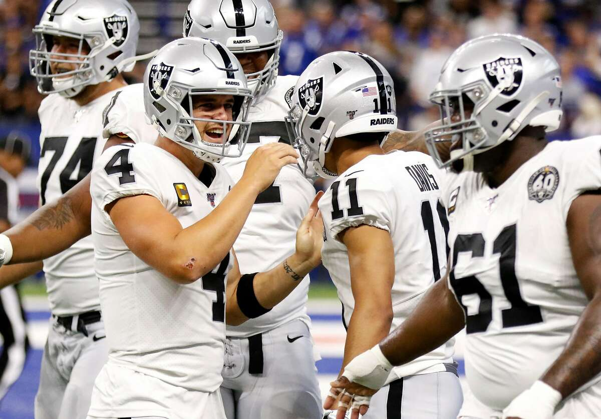Derek Carr #4 and Trevor Davis #11 of the Oakland Raiders celebrate a touchdown during the first quarter during game against the Indianapolis Colts at Lucas Oil Stadium on September 29, 2019 in Indianapolis, Indiana.