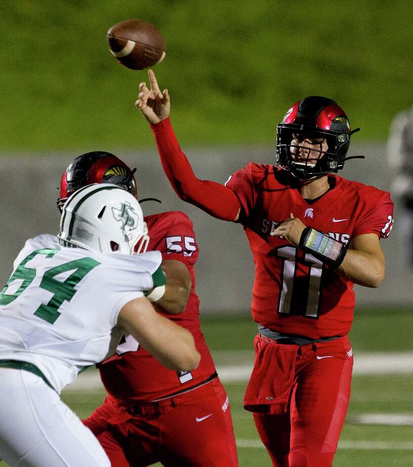 Porter quarterback Jack Reilly (11) throws a pass as defensive linemen Aurelio Alonzo (55) blocks Kingwood Park defensive linemen Ronan Keeler (64) during the second quarter of a District 9-5A high school football game at Randall Reed Stadium, Friday, Sept. 27, 2019, in New Caney. Photo: Jason Fochtman, Houston Chronicle / Staff Photographer / Houston Chronicle