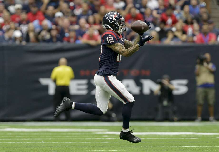 PHOTOS: Texans vs. Chiefs  Houston Texans wide receiver Kenny Stills (12) makes a catch against the Carolina Panthers during the first quarter of an NFL game at NRG Stadium Sunday, Sept. 29, 2019, in Houston. Stills got hurt on this play. The Panthers won 16-10. >>>See more photos from the Texans' win over the Chiefs on Sunday ...  Photo: Godofredo A Vásquez/Staff Photographer