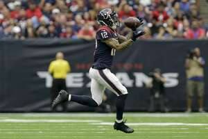 Houston Texans wide receiver Kenny Stills (12) makes a catch against the Carolina Panthers during the first quarter of an NFL game at NRG Stadium Sunday, Sept. 29, 2019, in Houston. Stills got hurt on this play. The Panthers won 16-10.