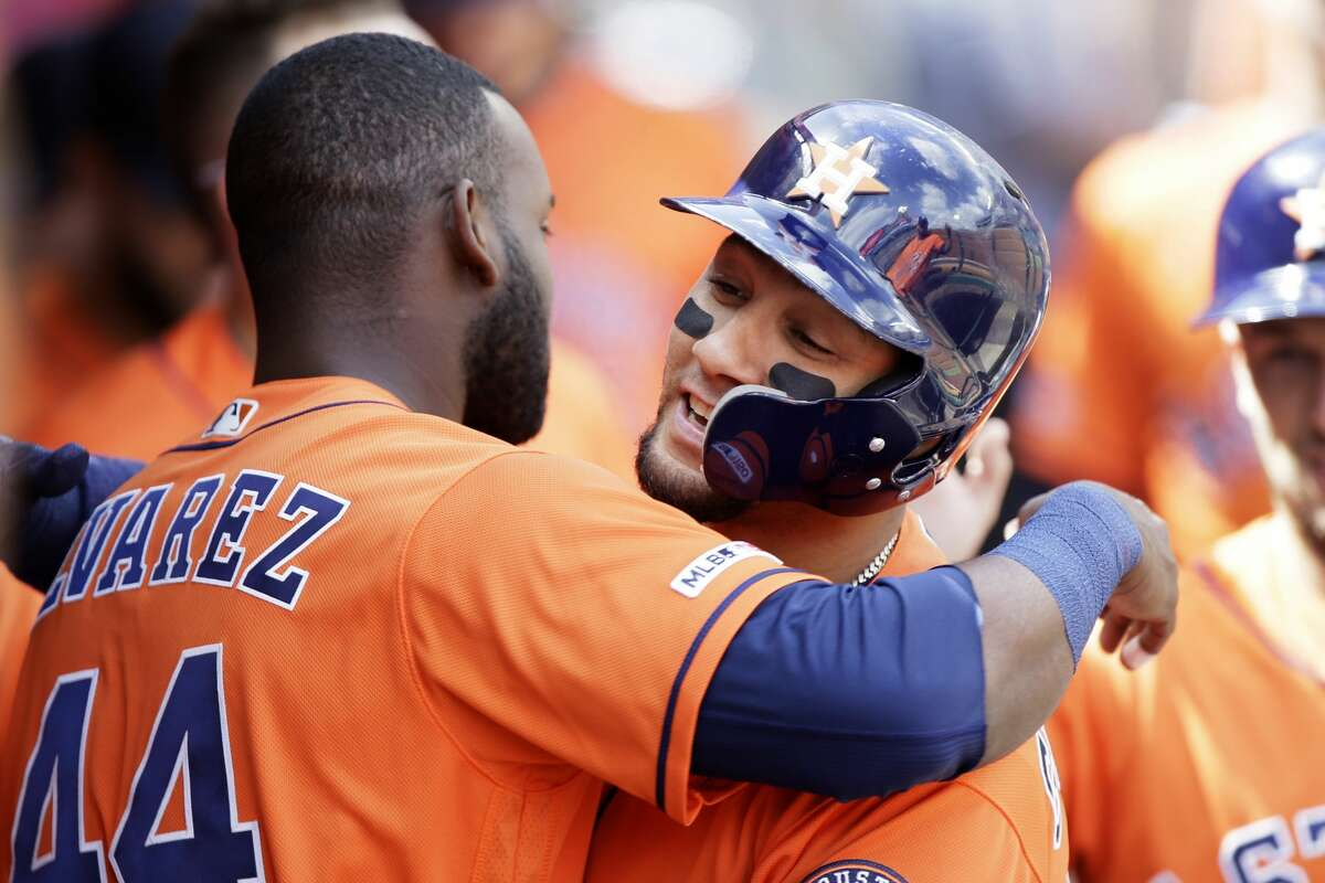 Houston Astros' Yuli Gurriel, right, gets a hug from Yordan Alvarez after hitting a two-run home run during the third inning of a baseball game against the Los Angeles Angels in Anaheim, Calif., Sunday, Sept. 29, 2019. (AP Photo/Alex Gallardo)