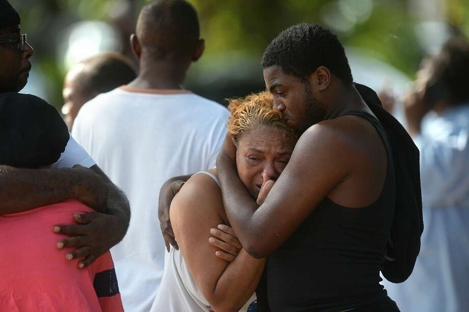 Beaumont Police investigate the shooting deaths of four people at a home at the intersection of Highland Avenue and Lavaca Street Sunday afternoon. Friends and family members of the victims gathered across the street for several hours after the shooting.  Photo taken Sunday, 9/29/19 Photo: Guiseppe Barranco/The Enterprise