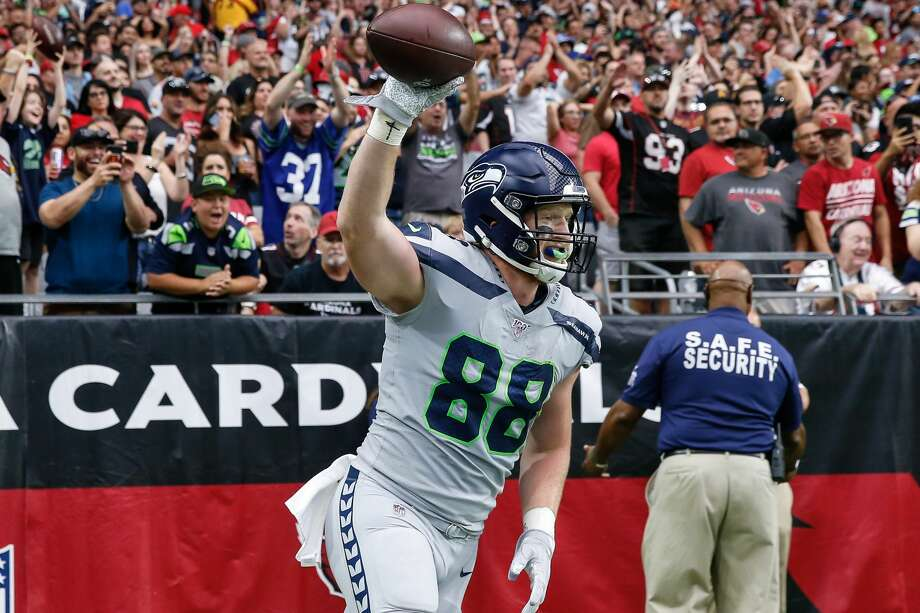 """DISSLY HAD BIG SHOWING IN RETURN TO DESERT The last time Will Dissly was in the desert, September of 2018, he left the game early on a cart with a torn patellar tendon — ending a standout rookie season at just four games.  Leaving Arizona this time around, the second-year tight end had many reasons to smile.  Dissly had a career-high seven receptions for a team-leading 57 yards and a touchdown in the Seahawks' victory over the Cardinals. The Washington alum was quarterback Russell Wilson's favorite target Sunday. Dissly's score, in the second quarter, was off a seam route — what's quickly becoming a go-to look for the Wilson-Dissly connection.  In eight career games, Dissly has 27 catches for 337 yards and six touchdowns. He has the most scores by a tight end through eight career games since 2005, according to Seahawks PR. Sunday also marked the second consecutive week he's recorded a career high in catches. Dissly had six receptions last week.  """"He's better right now than he's ever been,"""" Carroll said. """"He just continues to be a really, really, really dependable football player. I love the way he's playing. He and Russ are hooking up at crucial times for tough catches ... He's a tremendous Seahawk. He just does everything so beautifully."""" Photo: Kevin Abele/Icon Sportswire Via Getty Images / ©Icon Sportswire (A Division of XML Team Solutions) All Rights Reserved"""