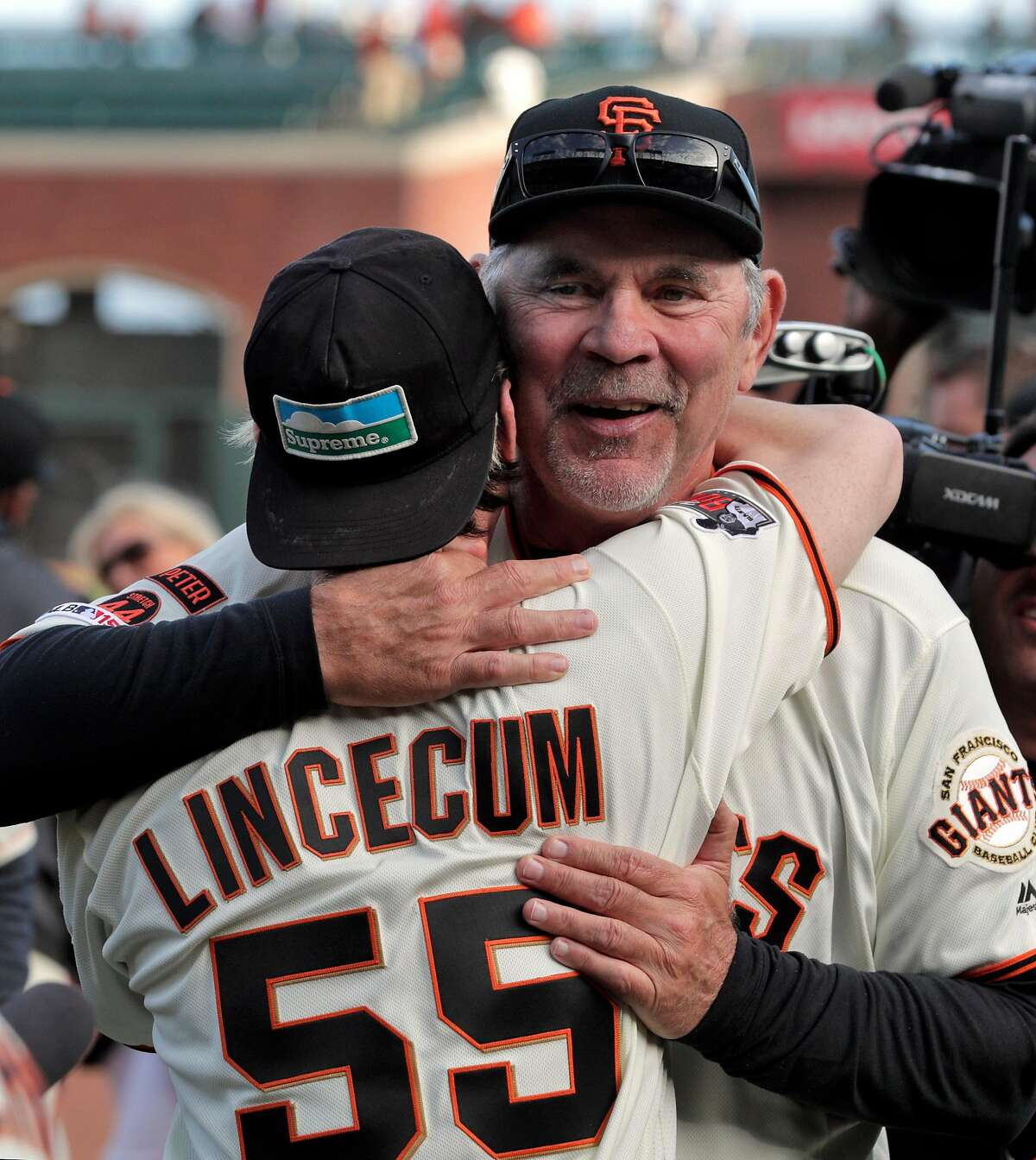 Giants manager Bruce Bochy hugs Tim Lincecum followning an onfield ceremony honoring Bochy after managed his final game with the San Francisco Giants at Oracle Park in San Francisco, Calif., on Sunday, September 29, 2019.