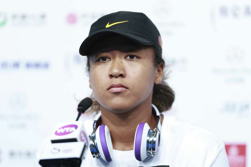 BEIJING, CHINA - SEPTEMBER 29: Naomi Osaka of Japan attends a press conference after winning her women's singles first round match against Jessica Pegula of the United States during women's singles first round match of 2019 China Open at the China National Tennis Center on September 29, 2019 in Beijing, China. (Photo by Lintao Zhang/Getty Images)