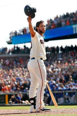 San Francisco Giants' Madison Bumgarner acknowledges the cheers of the crowd while pinch hitting in 5th inning against Los Angeles Dodgers during MLB game at Oracle Park in San Francisco, Calif., on Sunday, September 29, 2019.