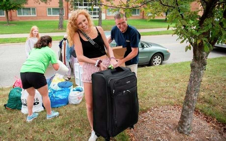 A family is shown moving their daughter into an SVSU residence hall prior to the beginning of Fall Semester late last month. (Photo by Michael Randolph, SVSU)