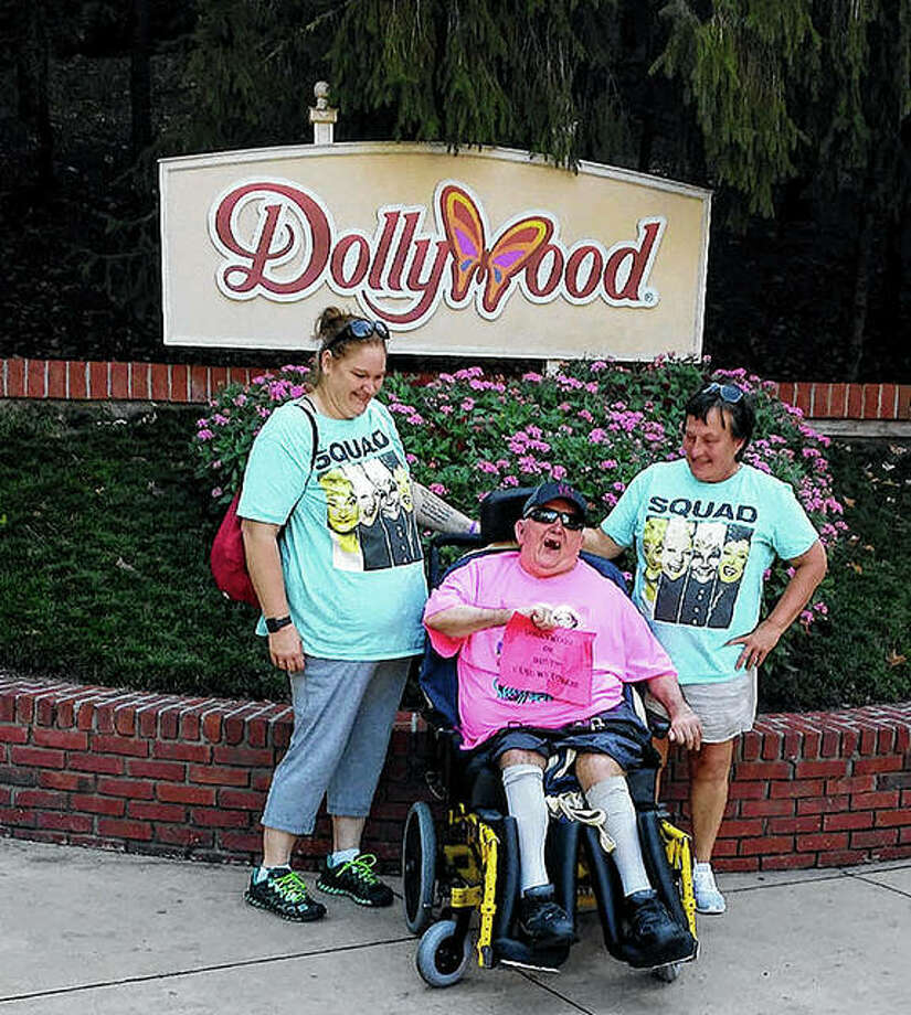 Amanda McEvers (from left), Jim Neavill and Sara Rochester visit Dollywood.