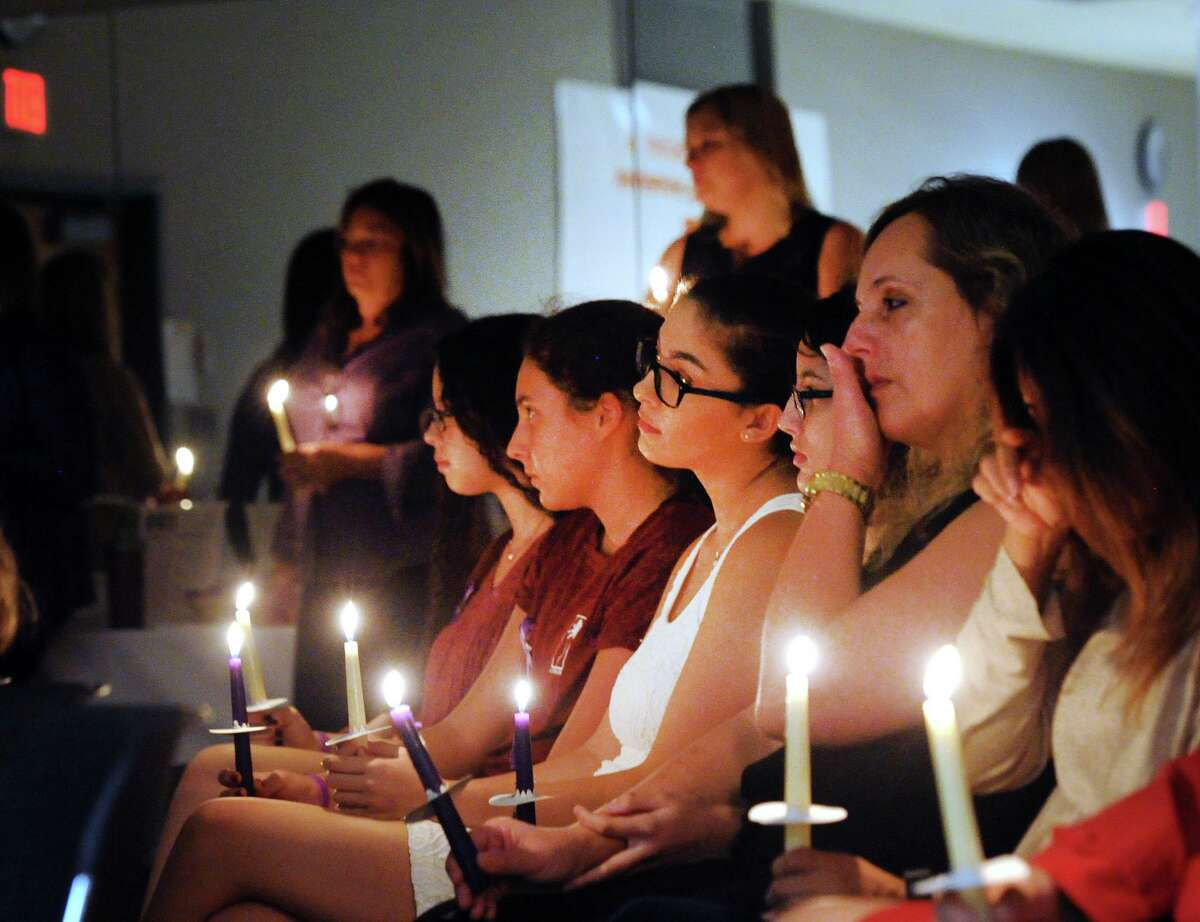 The YWCA of Greenwich Domestic Abuse Services annual Candlelight Vigil to honor the victims of domestic violence and abuse at the YWCA of Greenwich, Conn., Tuesday, Oct. 9, 2018. October is Domestic Violence Awareness Month.