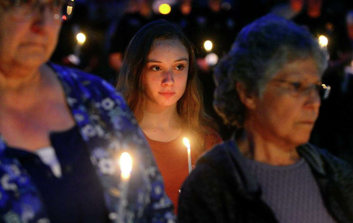 Molly Tripp, 14, of Seymour, attends The Umbrella Center for Domestic Violence Services (UCDVS) Candlelight Vigil held at the Gazebo at Huntington Center Green, in Shelton, Conn. on Tuesday Oct. 10, 2017. To raise awareness about domestic violence, (UCDVS) held the vigil to honor survivors and remember the victims of domestic violence. Geralyn O?'Neil-Wild, Director of Legal Advocacy at Connecticut Domestic Violence Fatality Review Committee (CCADV), was the keynote speaker. Local police officers were also recognized for their role in the fight against domestic violence.