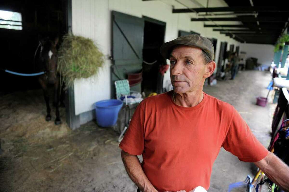 Tim Snyder, trainer and owner of Lisa's Booby Trap, stands in the stakes barn at the Saratoga Race Course. Lisa was the name of Snyder's wife, who died in 2003 of cancer. The horse will race Friday, Aug. 6 . (Skip Dickstein/Times Union)