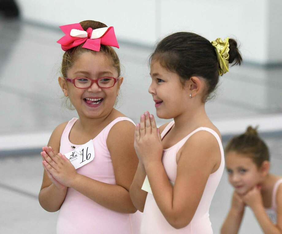 """Stamford's Liah Sandoval, left, 6, and Riverside's Nicole Solomon, 5, giggle during the audition for the upcoming production of """"The Nutcracker"""" at Connecticut Ballet Center in Stamford, Conn. Sunday, Sept. 29, 2019. About 100 dancers will be selected to perform in the annual holiday production, held on Dec. 21 and 22 this year. Since 1984, more than 2,800 local children have performed in the show, which also features guest stars from American Ballet Theatre and New York City Ballet. Photo: Tyler Sizemore / Hearst Connecticut Media / Greenwich Time"""