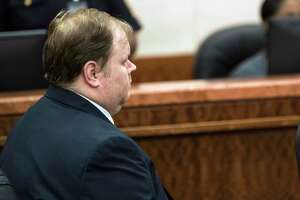 Ronald Haskell sits motionless as he was found guilty of capital murder on Thursday, Sept. 26, 2019, in Houston. Haskell who said voices in his head told him to kill six members of his ex-wife's family in Texas, including four children, was found guilty of capital murder Thursday by a jury that rejected his insanity defense.