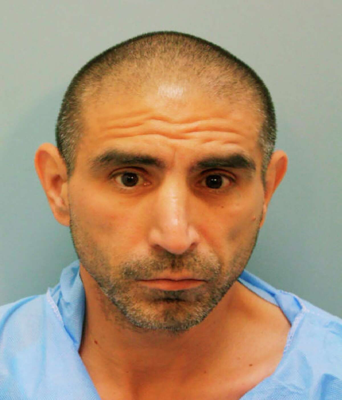 In this booking photo provided by Harris County Sheriff's Office is Robert Solis. Solis, 47, of Houston has been charged with capital murder in the Friday, Sept. 27, 2019, shooting death of Harris County Sheriff's Deputy Sandeep Dhaliwal, 42, during a traffic stop near Houston. (Harris County Sheriff's Office via AP)