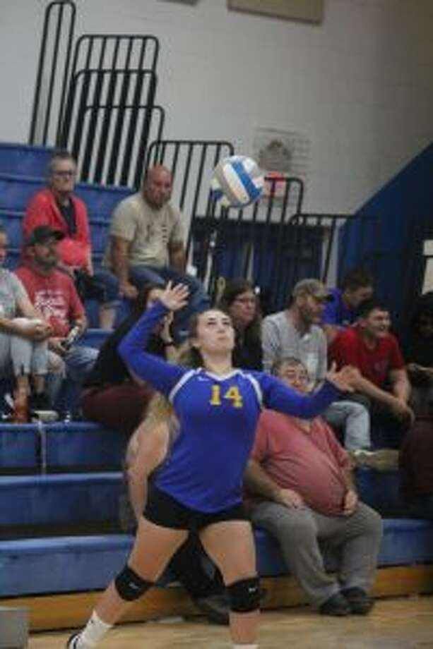 Livia Hopkins gets ready to serve in a recent match.