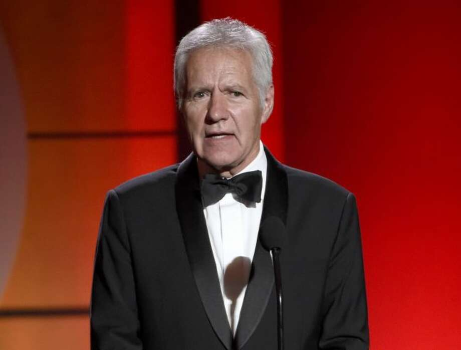 """In this April 30, 2017, file photo, """"Jeopardy!"""" host Alex Trebek speaks at the 44th annual Daytime Emmy Awards in Pasadena, Calif. Trebek has returned to work, saying he's """"on the mend"""" following treatment for pancreatic cancer. The 79-year-old posted a video Thursday, Aug. 29, 2019, on Twitter showing him back on the game show's set. He actually started work on July 22, his birthday. New episodes of the upcoming Season 36 are slated to begin airing on Sept. 9. (Photo by Chris Pizzello/Invision/AP, File)"""