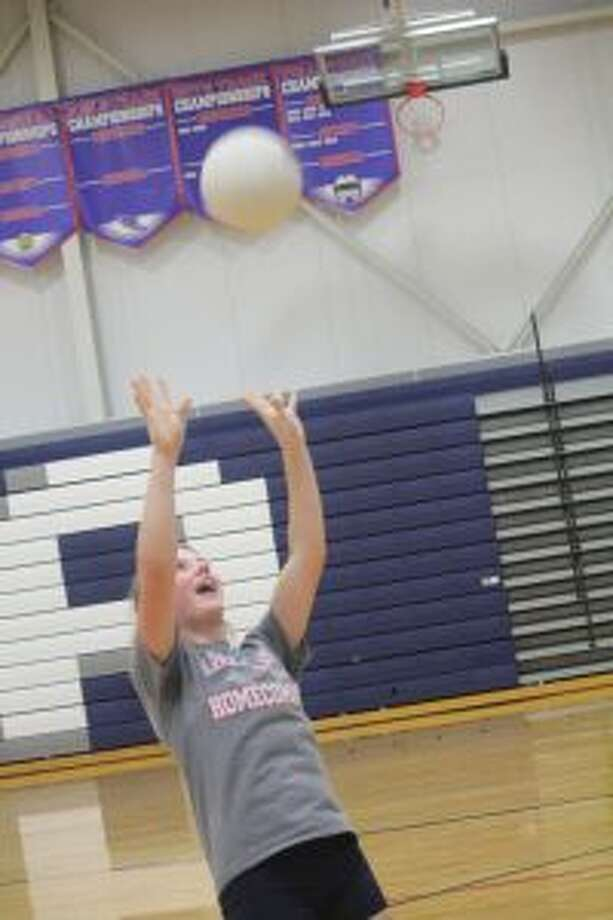 Maddie Alber sets the ball during practice.