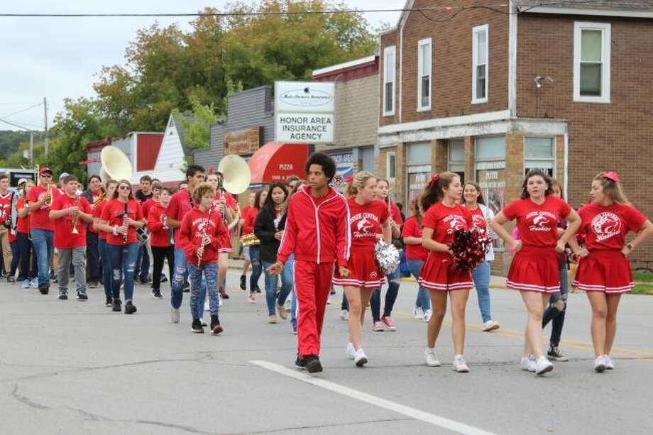 The Benzie Central High School Band, cheerleaders and other students participated in the National Coho Salmon Festival parade on Saturday. (Photo/Colin Merry)