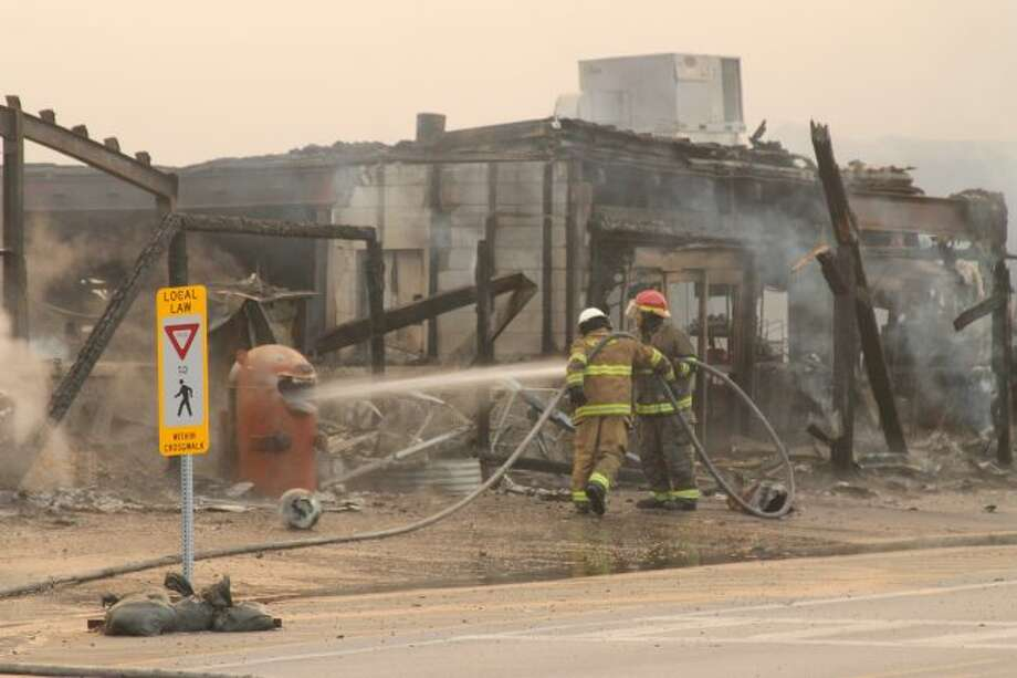 Firefighters battled a blaze at Dublin General Store in Wellston on Aug. 31. (Michelle Graves/News Advocate)
