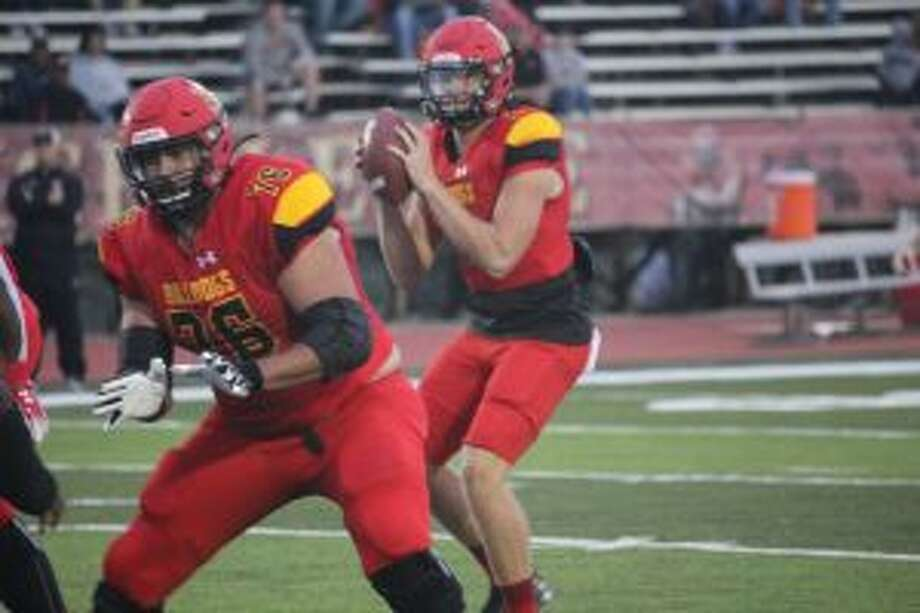 Ferris quarterback Travis Russell looks for a receiver.