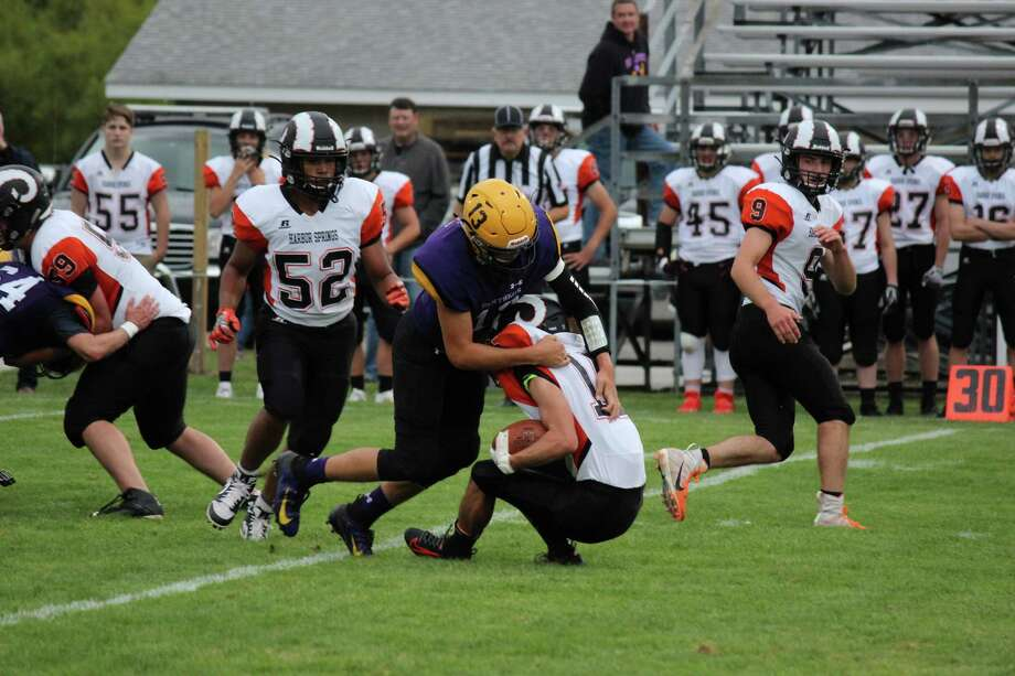 Adam Mills swallows up a ball carrier during a dominant defensive effort by the Panthers. (Photo/Robert Myers)