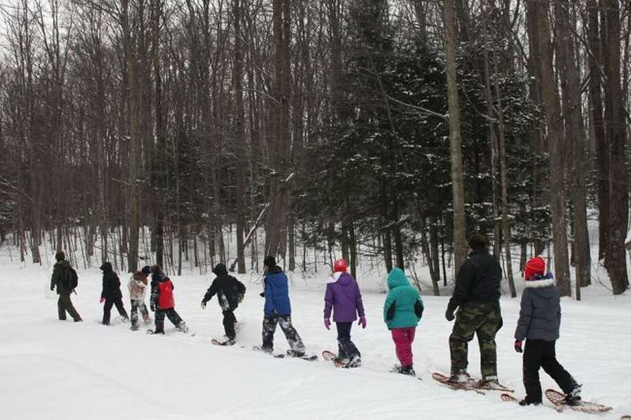 The Sleeping Bear National Lakeshore will be hosting a workshop for educators focusing on educational programs provided by the National Park Service they can use in, or out, of their classrooms, such as ranger-led snowshoe hikes. (Courtesy Photo)