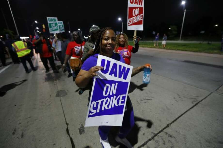 United Auto Workers members picket outside the General Motors Detroit-Hamtramck assembly plant in Hamtramck, Michigan, early Monday. (AP Photo/Paul Sancya)