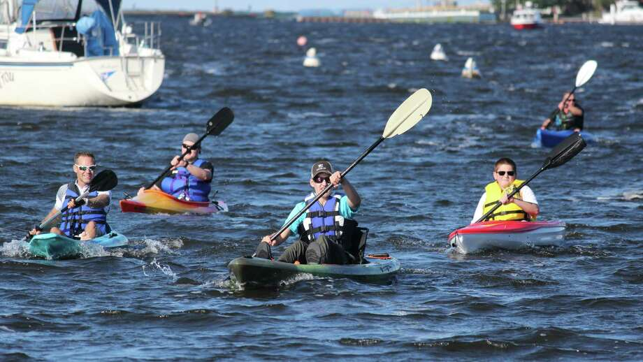 Paddlers make their way across the rough waters of Betsie Bay. (Photo/Robert Myers)