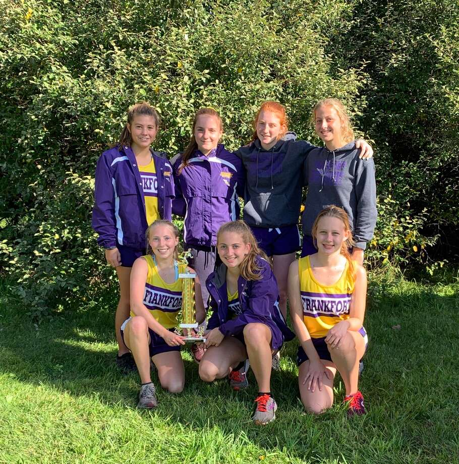 Frankfort's girls cross country team celebrates a championship trophy at the Ludington Cross Country Invitational. (Courtesy photo)