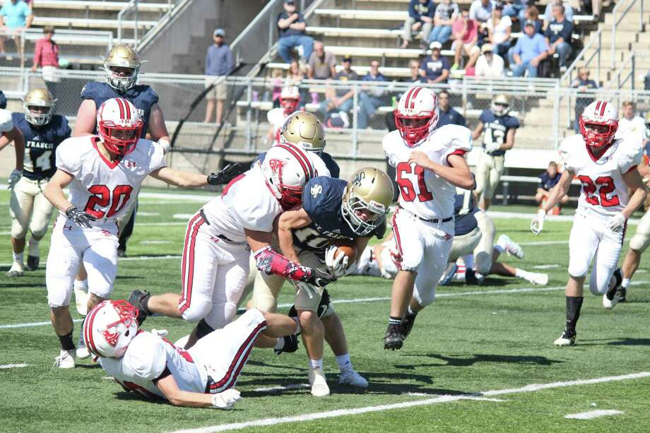 Cody Hanson comes up to make a big hit in the backfield. (Photo/Robert Myers)