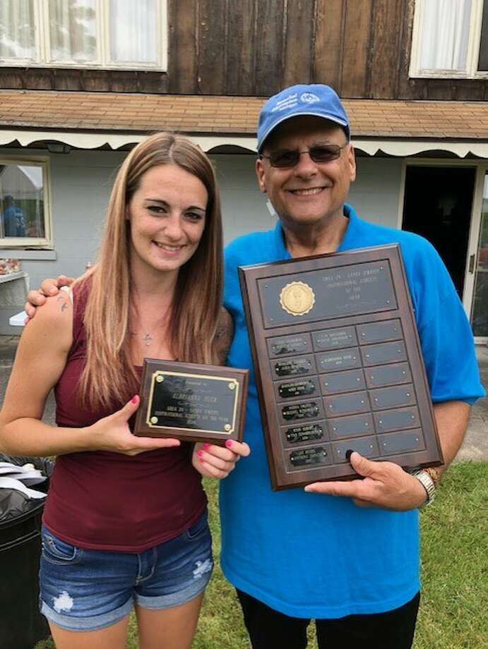 Pictured from left to right: Accepting an award for Albrianna is her mother, Jamie Harris. Presenting the award is Gary Boerema, assistant area director of Area 24. (Courtesy Photo)