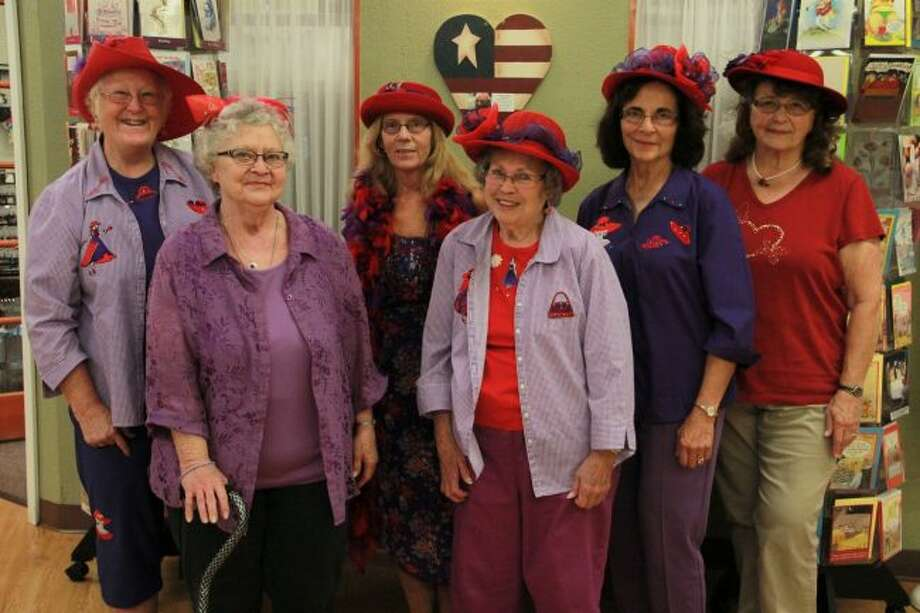 """Featured in this photo is JoAnne Gibbons, Jeanne Hanson, Valerie Bennett, Queen Mother Joyce Cooker, Elizabeth Lawrence and Sue Sheehan. The Red Hat Society is """"a playgroup for women created to connect like-minded women, make new friends and enrich lives through the power of fun and friendship,"""" according to the official Red Hat Society website. Members who have attained the age of 50 wear red hats and purple clothing, while those under 50 wear pink hats and lavender clothing. (Pioneer photo/Alicia Jaimes)"""