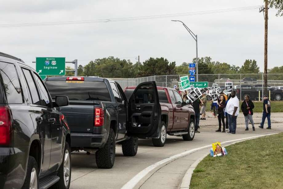 Protesting union members prevent cars from driving into the General Motors Flint Assembly Plant on Bristol Road as United Automobile Workers remain on strike against GM on Tuesday, Sept. 17, 2019, in Flint, Mich. (Sara Faraj/MLive.com/The Flint Journal via AP)