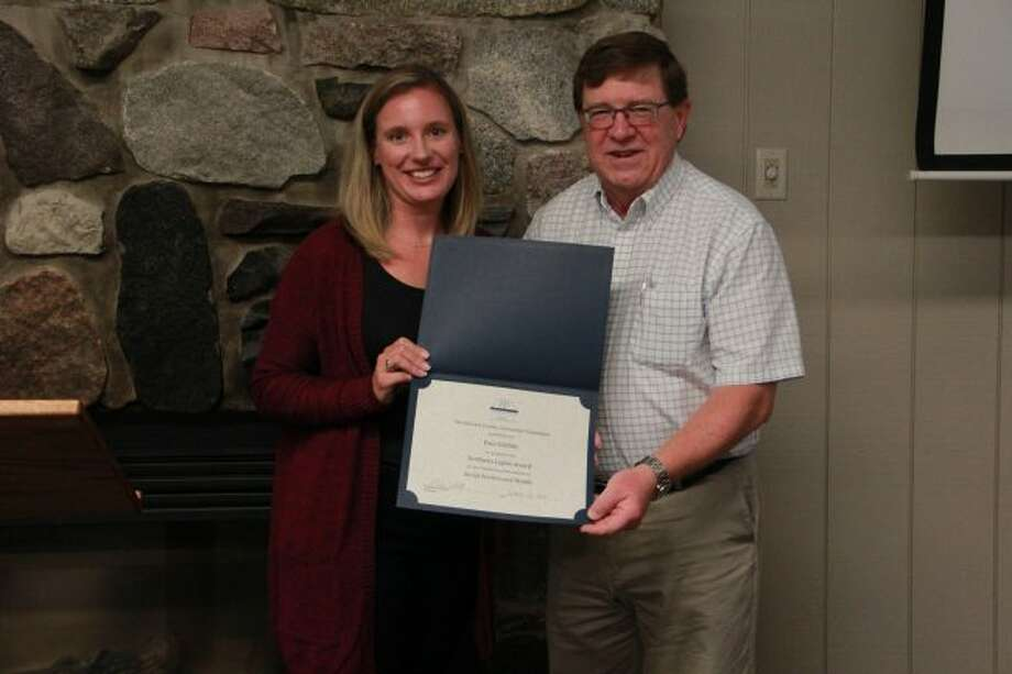 Laura Rhoades awarded Paul Griffith, on behalf of the Mecosta County Community Foundation, for his outstanding achievements in Social Services and Health. (Pioneer photo/Alicia Jaimes)