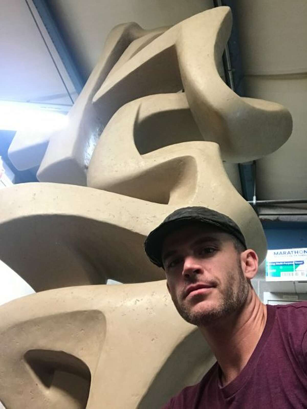 Artist Tyson Snow, who reproduced the sculpture, with the clay model of the Manierre Dawson sculpture, Daedayl, that will be unveiled at a 2 p.m. ceremony on Sept. 21.