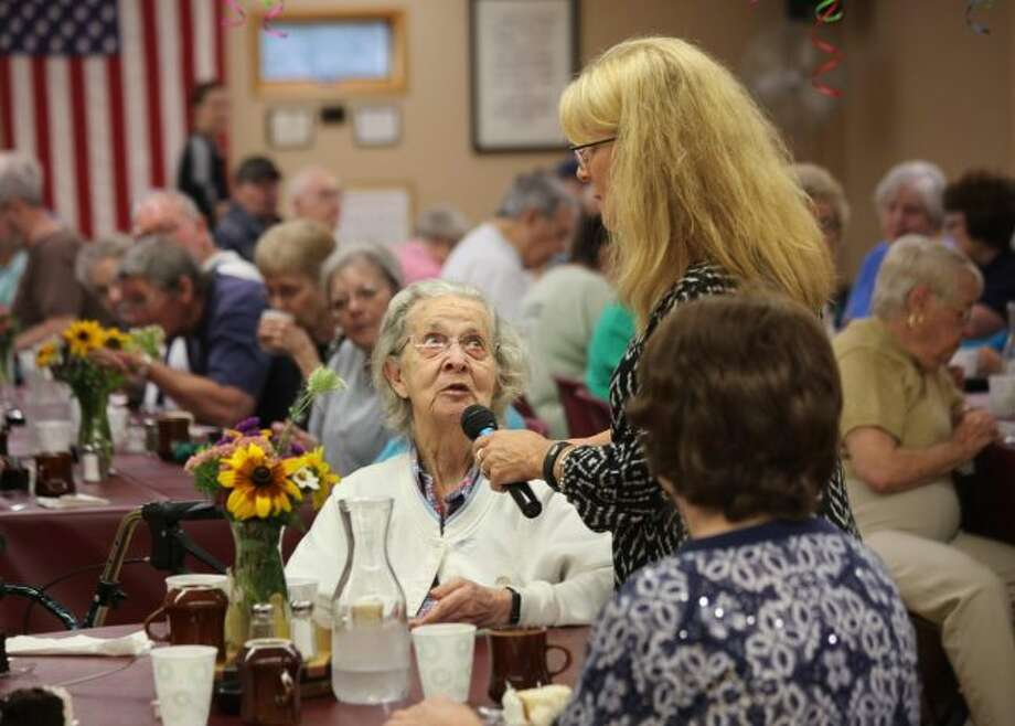 During the 90th Plus Birthday Celebration, COA program coordinator Beth Whyte goes around asking members to introduce themselves to other guests and asks for their age. (Courtesy photo)