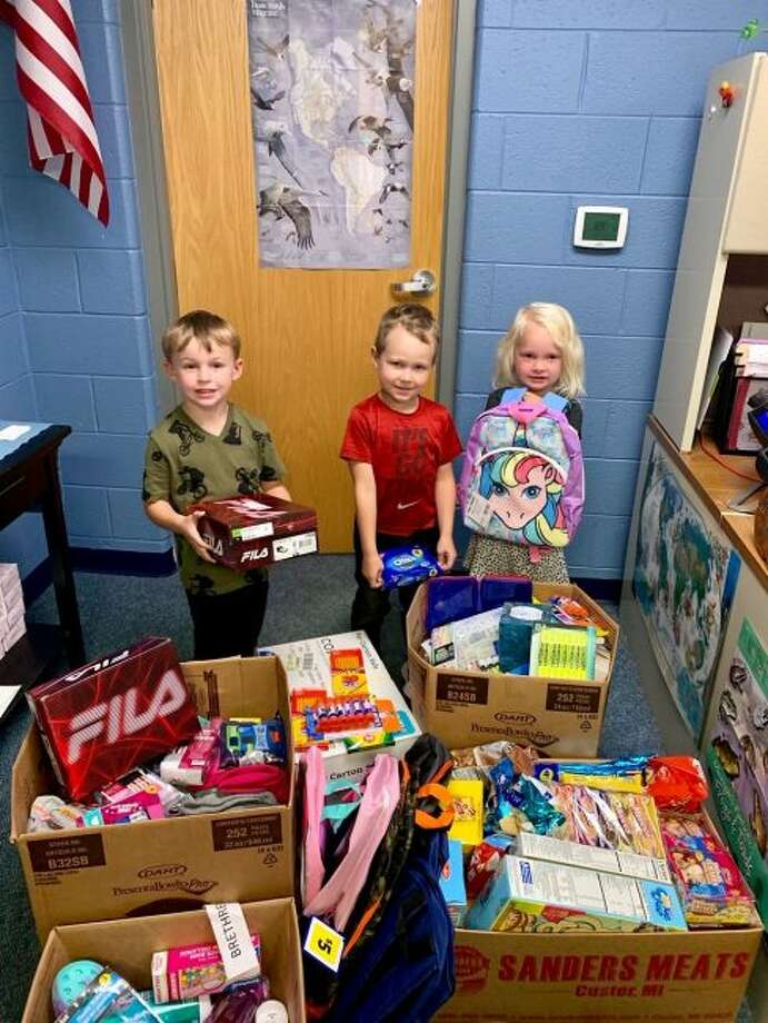 Students at Brethren Elementary School are all smiles when looking over the school items that were donated by the Little River Casino Resort employees