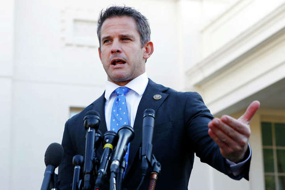 "Rep. Adam Kinzinger, R-Ill., speaks to the media at the White House in Washington. Kinzinger is slamming as ""beyond repugnant"" President Donald Trump's tweet of a conservative pastor's comment that removing Trump from office would provoke a ""civil war."" Jacquelyn Martin 