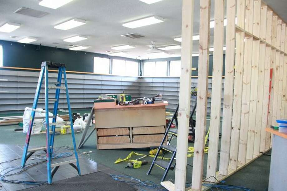 Construction for Hungry Howie's began Tuesday, Sept. 18, with a wall already in place, dividing the pizza store and Family Video. (Pioneer photo/Alicia Jaimes)