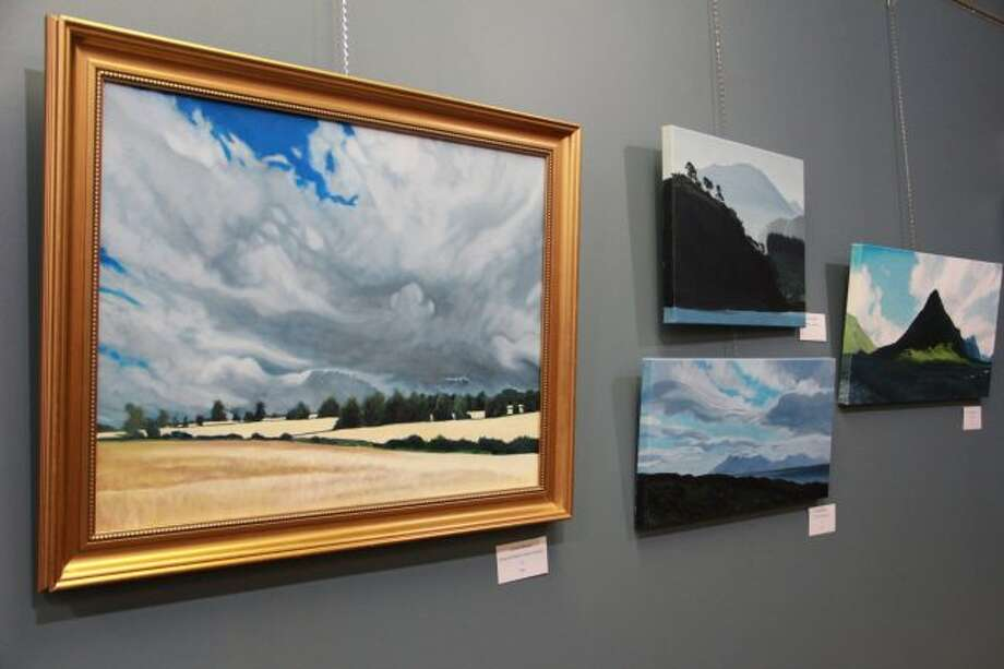 """Featured are a few pieces done by Artworks artists James """"JR"""" Roberts. Roberts work, according to Artworks executive director Lynne Scheible, is inspired by Scotland and Ireland. The exhibit will be in the Chemical Bank Lower Gallery in Artworks until the end of September. (Pioneer photo/Alicia Jaimes)"""