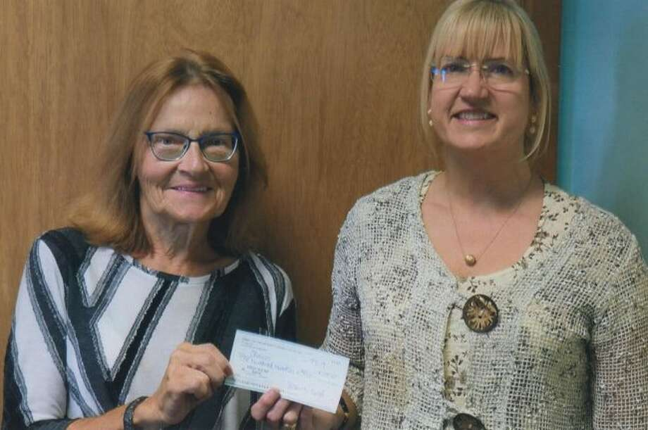 Spirit of the Woods Garden Club, Inc. members collected non-perishable and monetary items during their September meeting. Items were donated to CHOICES of Manistee County, to support women in crisis. Pictured are Jan Timm (left) and Anita Miejnek. (Courtesy photo)