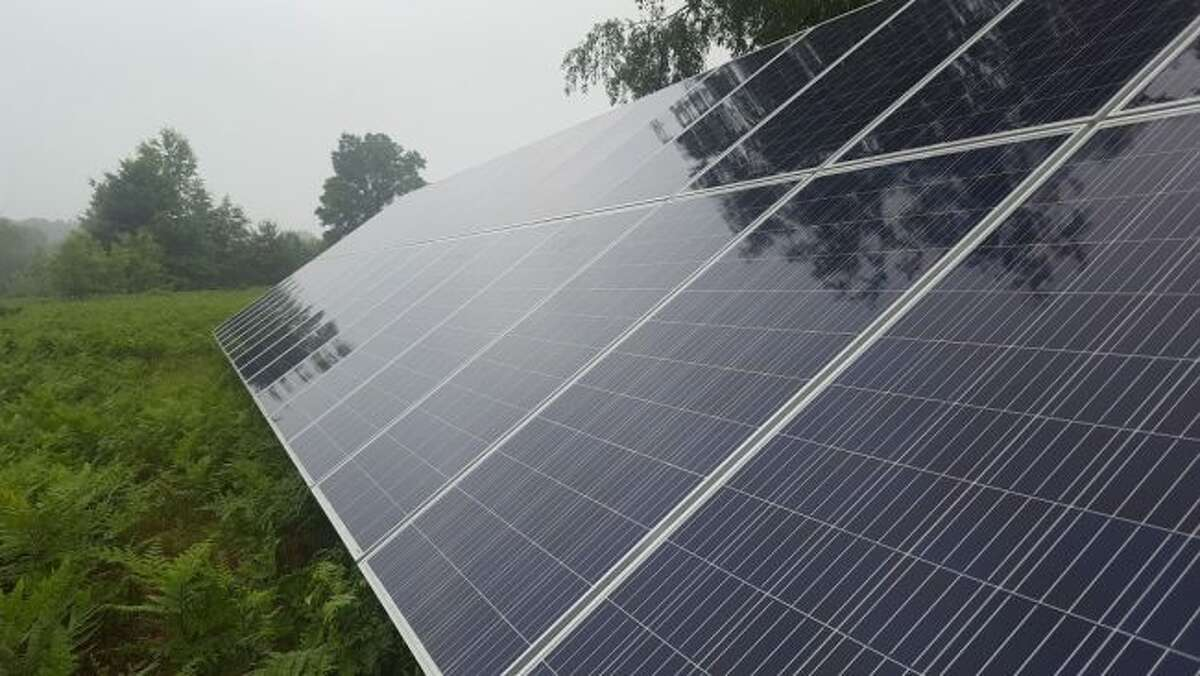 Nanci and Josh Swenson's house has a setup of 30 solar panels, stationed in a field in the backyard. Even on an overcast day, they gain enough energy from the panels to power their entire home. (Jane Bond/News Advocate)