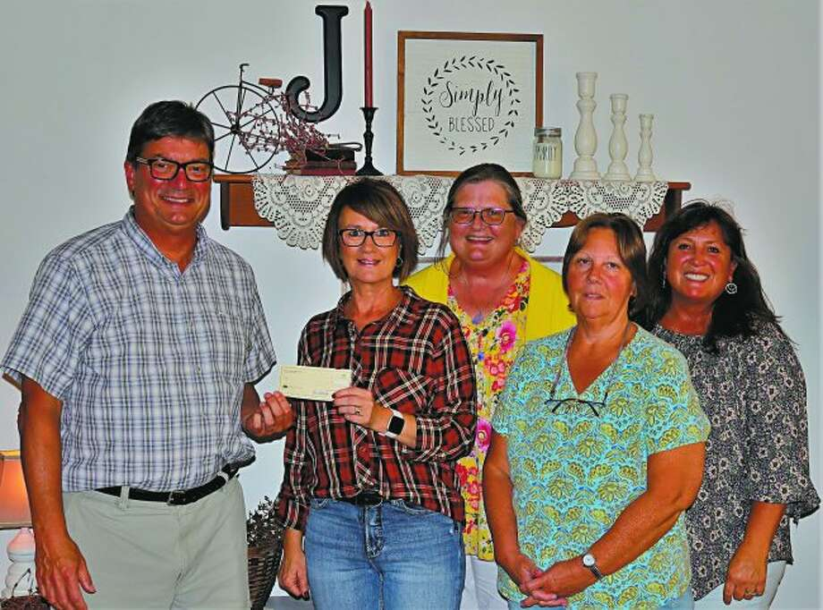 The Manistee High School Class of 1979 reunion committee met to finalize details and write a check for Blessings in a Backpack. Pictured is Tom Amor, Shelly Stendel-Johnson, Cathy Barnes-Baker, Karen Alberts and Laurie Drabik-Clark. Missing from the photo is Carl Lacki. (Courtesy Photo)
