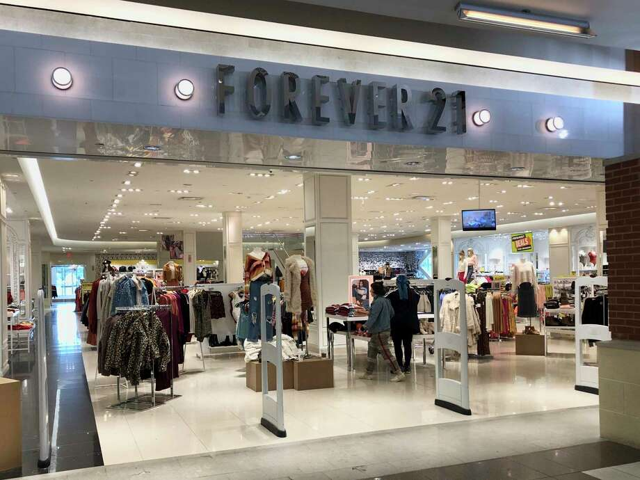 Customers arrive to shop at Forever 21 on Monday, Sept. 30, 2019, at Walden Galleria in Cheektowaga, N.Y. Forever 21 has filed for Chapter 11 bankruptcy protection. The privately held company based in Los Angeles said Sunday, Sept. 20, that it will close up to 178 stores in the U.S. (AP Photo/Bill Sikes) Photo: Bill Sikes / Associated Press / ap